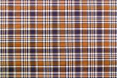 Modelos de la tela escocesa en Brown, azules marinos oscuros, y blanco Foto de archivo libre de regalías
