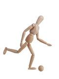 Modelos de madeira que jogam o futebol Imagens de Stock