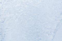 Modelos del hielo sobre el vidrio del invierno Foto de archivo libre de regalías