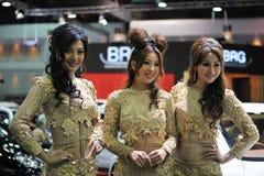 Modelos en una demostración de motor de Bangkok Imagenes de archivo