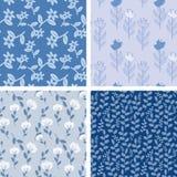 Modelos florales azules stock de ilustración