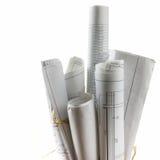 Modelos y rollos arquitectónicos del modelo en el fondo blanco Imagen de archivo libre de regalías