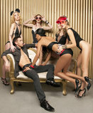Models. Male is surronded by a group of attractive females Stock Images