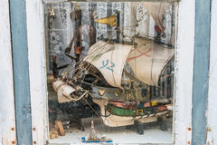 Models of ancient ships and boats behind old window Royalty Free Stock Photography