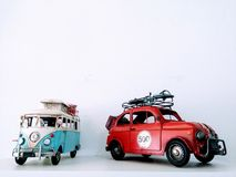 Models of camper van and car on white background stock images