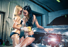 Models at the car wash in garage. Stock Photo