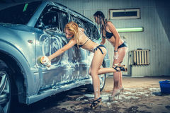Models at the car wash in garage Royalty Free Stock Photo