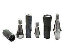 Models of dental titanium implants. On white Stock Image