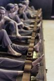 Models of detained prisoners by lock their foot ankle on something like wooden console at Hoa Lo Prison Museum in Hanoi, Vietnam Royalty Free Stock Photo