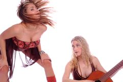 Models with guitar dancing Stock Photos