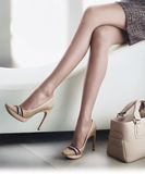 Models legs with red high heels shoes and bag Royalty Free Stock Image