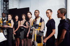 Models lineup backstage at the New York Life fashion show during MBFW Fall 2015 Stock Photos