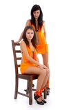 Models in orange dresses Stock Photo