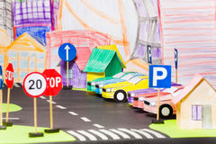 Models of paper cars at the parking in toy city