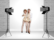 Models in photo studio with spotlights Stock Images