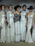 Models pose at the Claire Pettibone Bridal SS 2016 Runway Show Stock Images