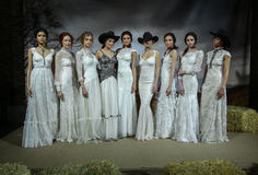 Models pose at the Claire Pettibone Bridal SS 2016 Runway Show Stock Photography