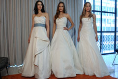 Models pose at the Henry Roth Bridal Spring 2016 Collection presentation. NEW YORK, NY - APRIL 22: Models pose at the Henry Roth Bridal Spring 2016 Collection Stock Images