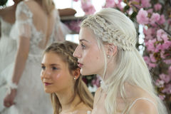 Models pose during the Marchesa Spring/Summer 2018 Couture Bridal presentation Stock Photography