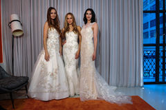 Models pose at the Michelle Roth Bridal Spring 2016 Collection presentation. NEW YORK, NY - APRIL 22: Models pose at the Michelle Roth Bridal Spring 2016 Stock Photography