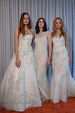 Models pose at the Michelle Roth Bridal Spring 2016 Collection presentation. NEW YORK, NY - APRIL 22: Models pose at the Michelle Roth Bridal Spring 2016 Royalty Free Stock Photo