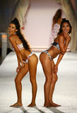 Models pose on the  runway in designer swim apparel during the Frankies Bikinis fashion show Royalty Free Stock Image