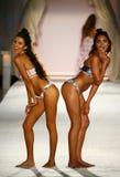 Models pose on the runway in designer swim apparel during the Frankies Bikinis fashion show. MIAMI, FL - JULY 18: Models pose on the runway in designer swim royalty free stock image