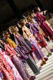 Models pose on the runway during the Dries Van Noten show Stock Photos