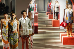 Models pose on the runway during the Kenzo show Stock Photo