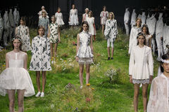 Models pose on the runway during the Moncler Gamme Rouge show. PARIS, FRANCE - OCTOBER 07: Models pose on the runway during the Moncler Gamme Rouge show as part Stock Image