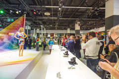 Models pose for visitors at Photokina Stock Images