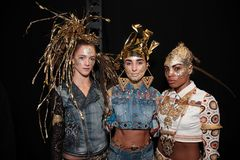 Models posing backstage before the Desigual fashion show royalty free stock photos