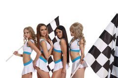 Models in skirts and tops with race flags royalty free stock images