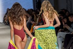 Models with swimsuit catwalk. In a fashion show, athens, greece royalty free stock images