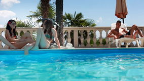 Models talk at the pool.  stock video