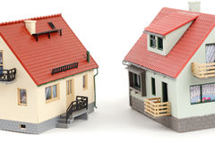 Models of two houses on white background Stock Photo