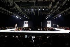 Models walk at podium in Gostiny Dvor Stock Photo