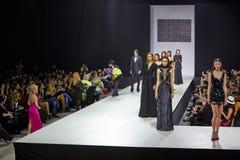 Models walk at podium Stock Photography