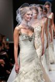 Models walk runway at Badgley Mischka fashion show during Fall 2015 Bridal Collection Stock Images