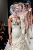 Models walk runway at Badgley Mischka fashion show during Fall 2015 Bridal Collection Stock Images