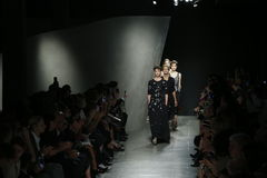 Models walk the runway during Bottega Veneta show as a part of Milan Fashion Week Stock Images