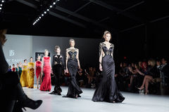 Models walk runway in Dany Tabet dress at the New York Life fashion show during MBFW Fall 2015. NEW YORK, NY - FEBRUARY 19: Models walk runway in Dany Tabet stock images