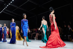 Models walk runway in Dany Tabet dress at the New York Life fashion show during MBFW Fall 2015 Royalty Free Stock Image