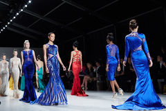 Models walk runway in Dany Tabet dress at the New York Life fashion show during MBFW Fall 2015. NEW YORK, NY - FEBRUARY 19: Models walk runway in Dany Tabet royalty free stock images