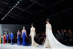 Models walk runway in Dany Tabet dress at the New York Life fashion show during MBFW Fall 2015 Stock Photos