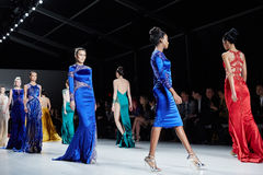 Models walk runway in Dany Tabet dress at the New York Life fashion show during MBFW Fall 2015 Stock Photography