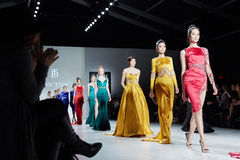 Models walk runway in Dany Tabet dress at the New York Life fashion show during MBFW Fall 2015 Stock Photo
