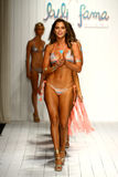 Models walk runway in designer swim apparel during the Luli Fama Swimwear fashion show. MIAMI, FL - JULY 18: Models walk runway in designer swim apparel during Royalty Free Stock Images