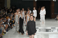 Models walk the runway finale during the Chalayan show. PARIS, FRANCE - OCTOBER 02: Models walk the runway finale during the Chalayan show as part of the Paris Royalty Free Stock Photo