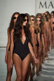 Models walk runway finale in designers swim apparel during the Maxim Swimwear Launch fashion show. MIAMI, FL - JULY 18: Models walk runway finale in designers Royalty Free Stock Photo